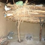 The Water Project: Kalenda A Community, Moro Spring -  Firewood Drying Over Cookstove