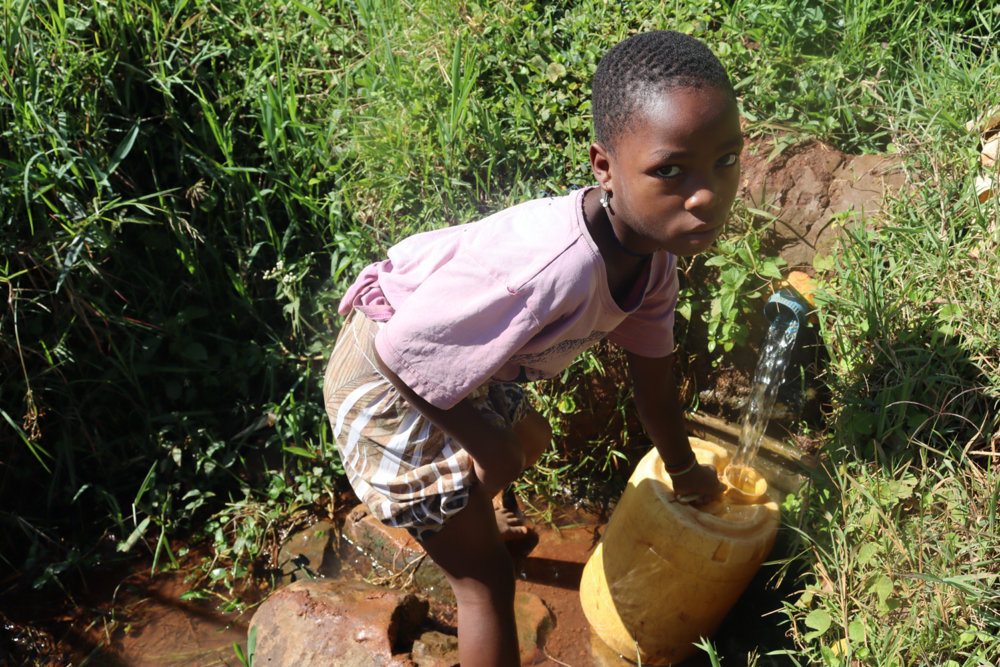 The Water Project : kenya21017-a-girl-fetching-water