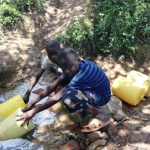 The Water Project: Luyeshe Community, Khausi Spring -  Two Boys Fetching Water