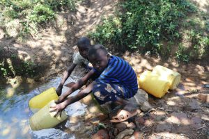 The Water Project:  Two Boys Fetching Water