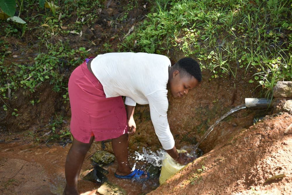 The Water Project : kenya21045-rinsing-her-container-3