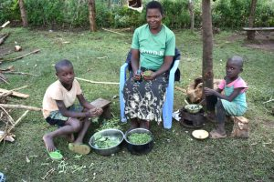 The Water Project:  A Family Preparing Greens For Lunch