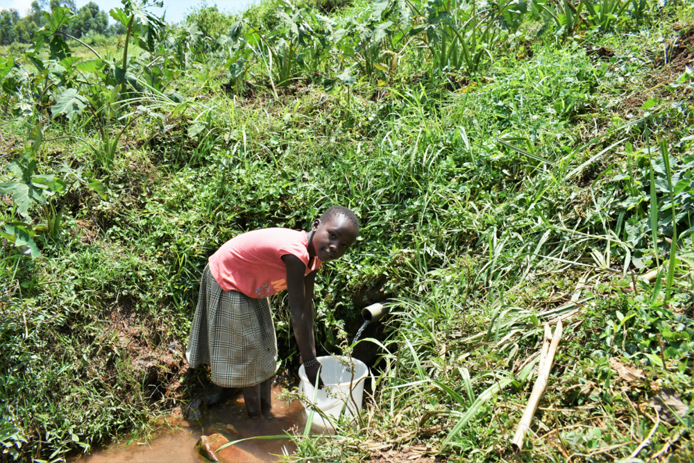 The Water Project : kenya21064-faith-fetching-water