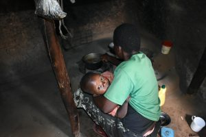 The Water Project:  A Mother Preparing Food