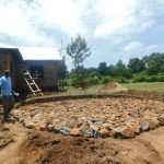 The Water Project: ACK St. Peter's Khabakaya Secondary School -  Laying Rocks On Foundation