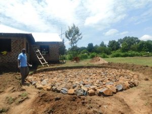 The Water Project:  Laying Rocks On Foundation