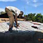 The Water Project: Makunga Secondary School -  Fitting Dome Skeleton To Tank