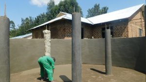 The Water Project:  Plastering Support Pillars
