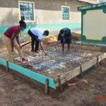 The Water Project: Makunga Secondary School -  Team Leader Emmah And Staff Check Measurements Of Latrine Foundation