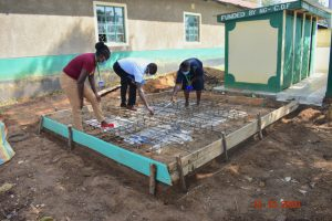 The Water Project:  Team Leader Emmah And Staff Check Measurements Of Latrine Foundation