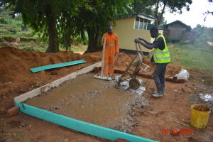 The Water Project:  Pouring Concrete Latrine Foundation