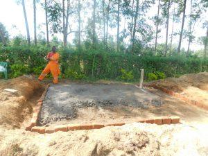 The Water Project:  Pouring Latrine Foundation