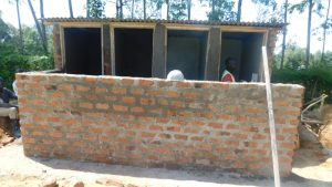 The Water Project:  Cementing Latrine Walls