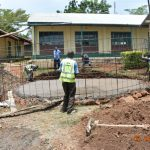 The Water Project: Makunga Secondary School -  Fitting Wire Form Over Foundation