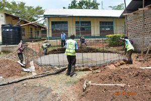The Water Project:  Fitting Wire Form Over Foundation