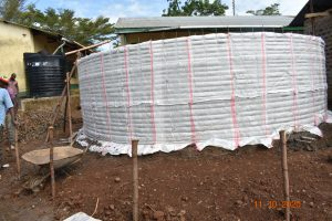 The Water Project:  Sugar Sacks Tied To Tank Wire