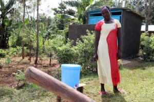The Water Project:  Next To Her Handwashing Station