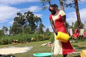 The Water Project:  Pouring Water For Laundry