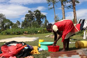 The Water Project:  Washing Clothes Using Spring Water