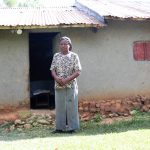 The Water Project: Shitoto Community, William Manga Spring -  Adelide Outside Her Home