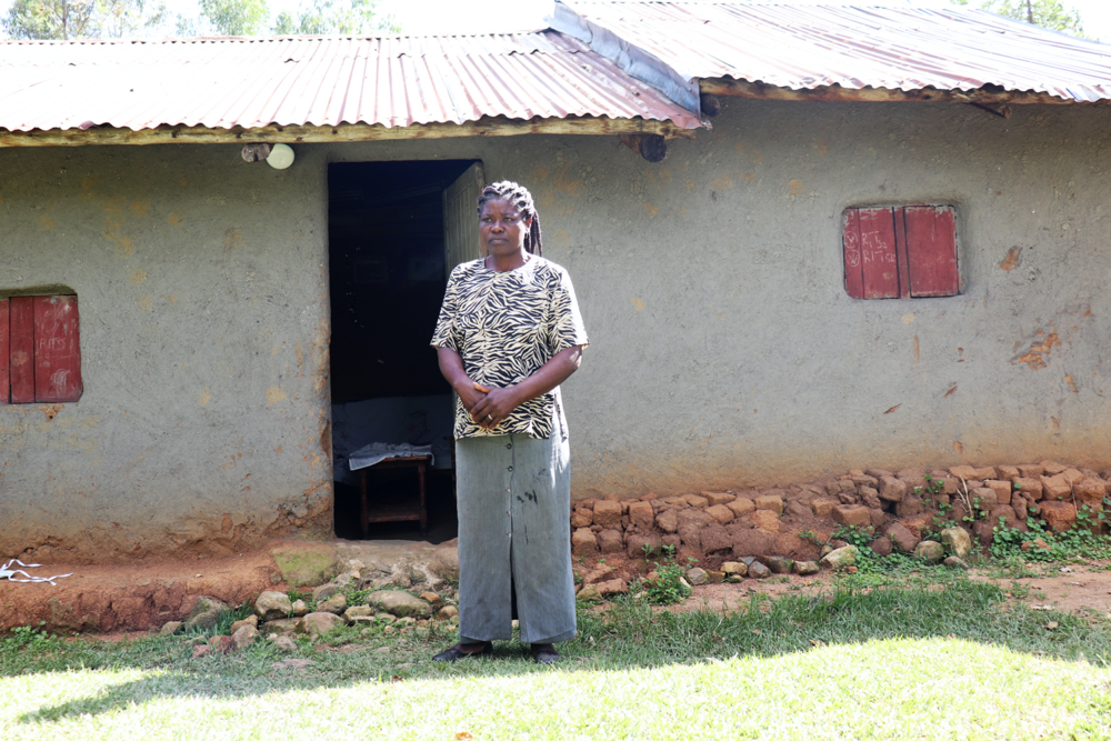 The Water Project : covid19-kenya4743-adelide-outside-her-home