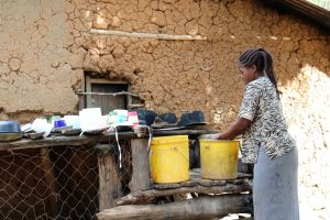 The Water Project:  Washing Utensils Using Spring Water