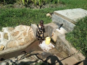 The Water Project:  Fetching Water From The Reservoir Tank