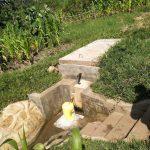 The Water Project: Eshiakhulo Community, Asman Sumba Spring -  Reservoir Tank