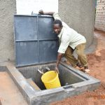 The Water Project: Makunga Secondary School -  Collecting Water For Curing The Tank