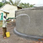 The Water Project: Makunga Secondary School -  Using Water From Tank For Curing