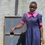The Water Project: Jinjini Friends Primary School -  Gloria At The Rain Tank