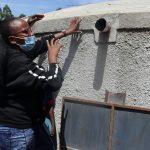 The Water Project: Jinjini Friends Primary School -  Rain Tank Maintenance Training