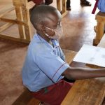 The Water Project: Mukoko Baptist Primary School -  Bramwel Following Discussion Keenly