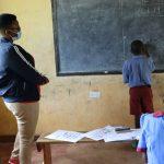 The Water Project: Mukoko Baptist Primary School -  Emmanuel Drawing His Interpretation Of The Coronavirus