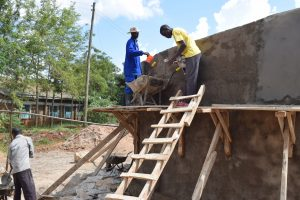 The Water Project:  Artisans Work On The Roof