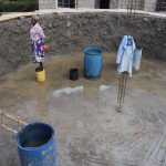 The Water Project: Mutulani Secondary School -  Cementing The Inside Of The Tank