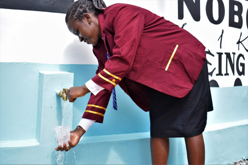The Water Project : kenya20350-student-fills-up-glass-at-the-tank