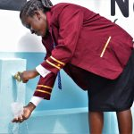 The Water Project: Mutulani Secondary School -  Student Fills Up Glass At The Tank