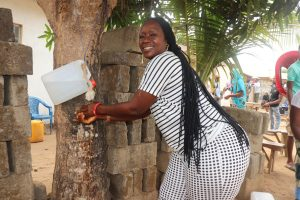 The Water Project:  Participant Demonstrating Handwashing