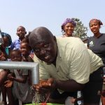 The Water Project: Lungi, New London, #10 Dankama Street -  Community Members Drinking Water