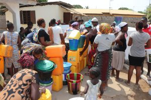 The Water Project:  Community Queueing To Collect Water Just After Dedication