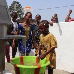 The Water Project: Lungi, New London, #10 Dankama Street -  Kids Celebrating And Splashing Clean Water