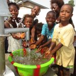 The Water Project: Lungi, New London, #10 Dankama Street -  Kids Happy Splashing Clean Water