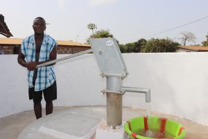 The Water Project:  Young Man Collecting Clean And Safe Drinking Water