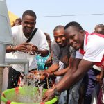 The Water Project: Lungi, New London, #10 Dankama Street -  Young Men Splashing Clean And Safe Drinking Water