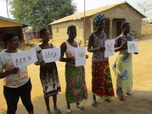 The Water Project:  Participants Displaying Disease Transmission Story Postals