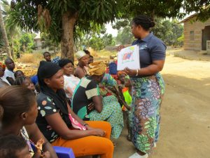 The Water Project:  Hygiene Facilitator Teaching About Good Hygiene Practices