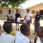 The Water Project: Lungi, Mahera, #5 MacAuley Street -  Participants Demostrating One Of The Handwashing Method