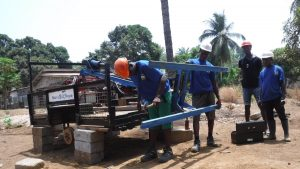 The Water Project:  Setting Up Manchine For Drilling