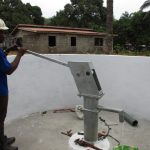 The Water Project: Lungi, Mahera, #5 MacAuley Street -  Staff Collecting After Finished Installing Pump